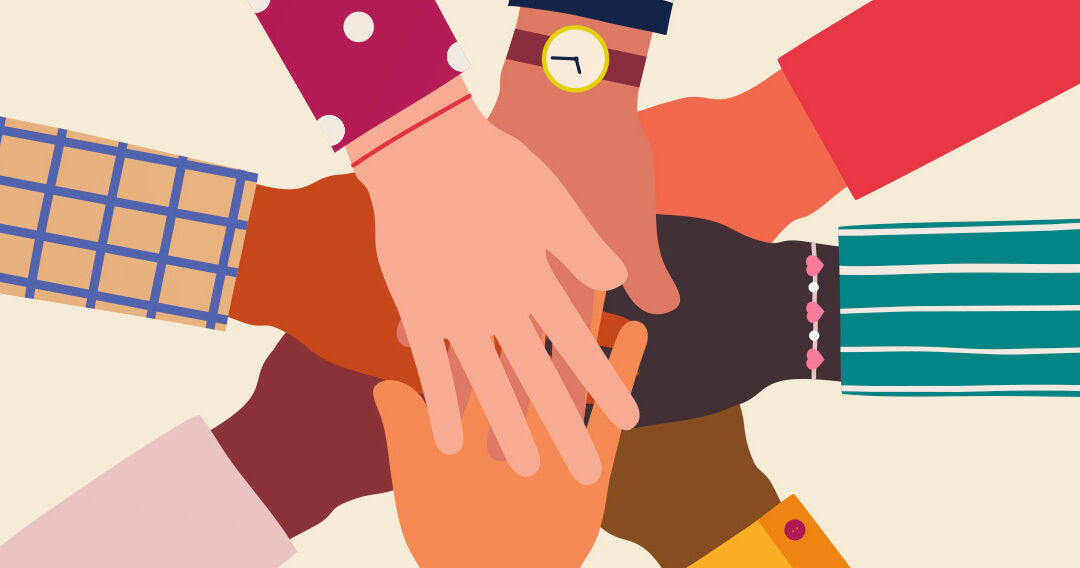 eight hands touching in show of unity and teamwork